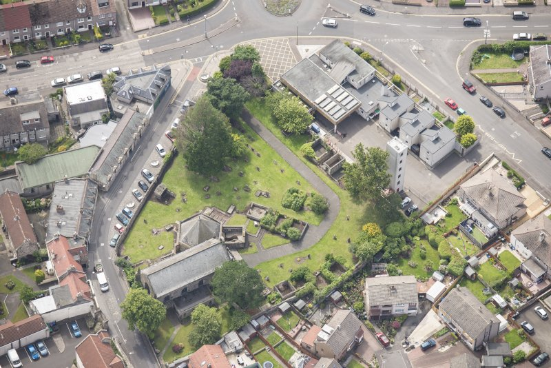 Oblique aerial view of St Triduana's Chapel, Restalrig Parish Church and Churchyard, looking S.