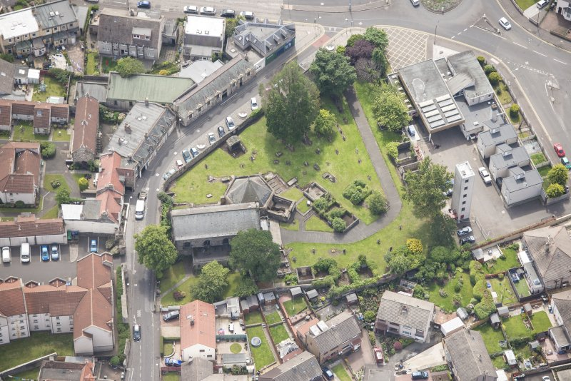 Oblique aerial view of St Triduana's Chapel, Restalrig Parish Church and Churchyard, looking SSE.
