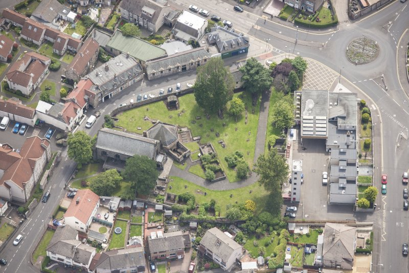 Oblique aerial view of St Triduana's Chapel, Restalrig Parish Church and Churchyard, looking SE.