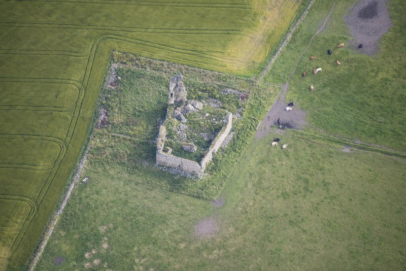Oblique aerial view of Inverallochy Castle, looking NE.