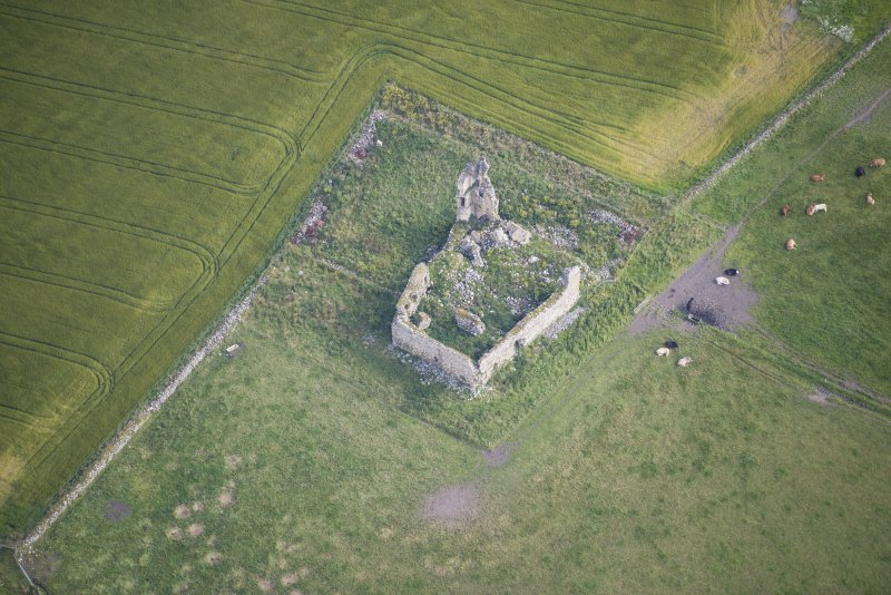 Oblique aerial view of Inverallochy Castle, looking NNE.