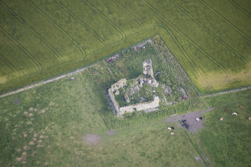 Oblique aerial view of Inverallochy Castle, looking NNW.