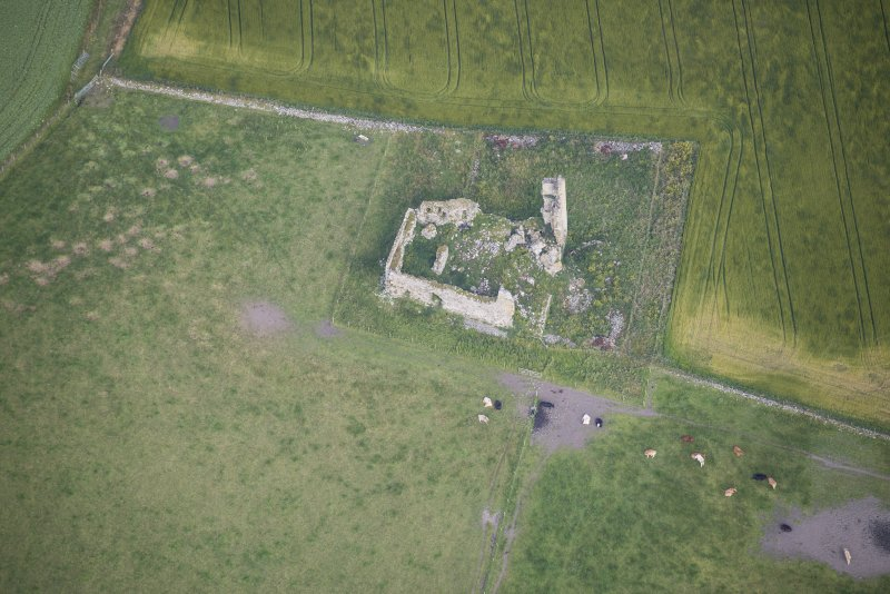 Oblique aerial view of Inverallochy Castle, looking NW.