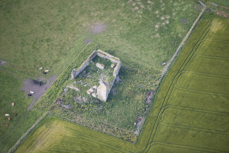 Oblique aerial view of Inverallochy Castle, looking SSW.