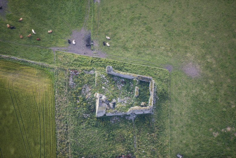 Oblique aerial view of Inverallochy Castle, looking SSE.