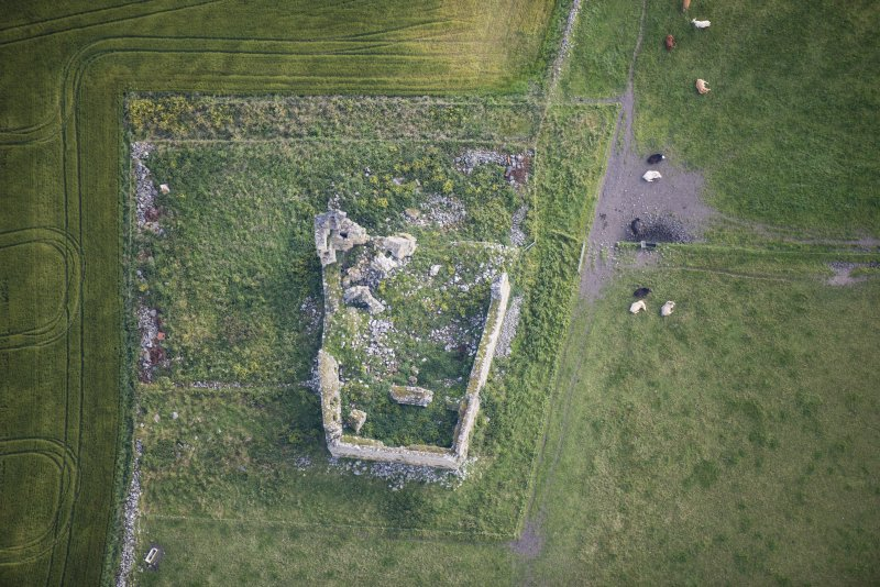 Oblique aerial view of Inverallochy Castle, looking ENE.