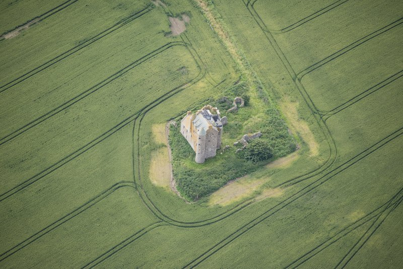 Oblique aerial view of Inchdrewer Castle, looking SSE.