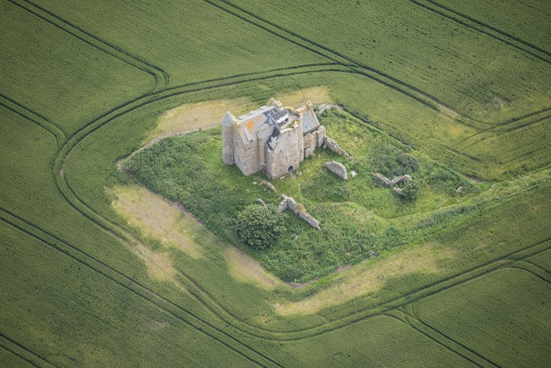 Oblique aerial view of Inchdrewer Castle, looking E.