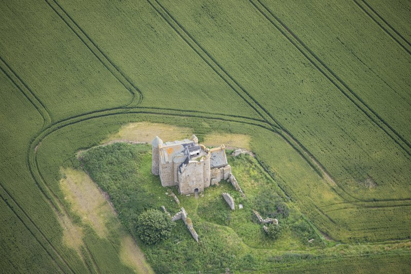 Oblique aerial view of Inchdrewer Castle, looking NE.