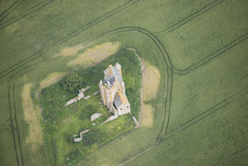 Oblique aerial view of Inchdrewer Castle, looking NW.