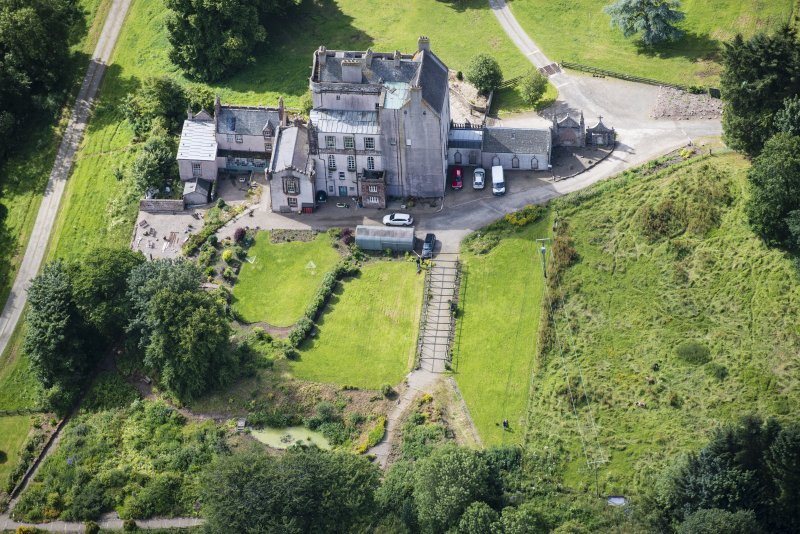Oblique aerial view of Delgatie Castle, looking S.
