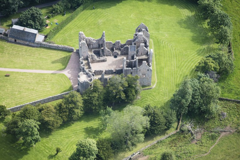 Oblique aerial view of Tolquhon Castle, looking ENE.