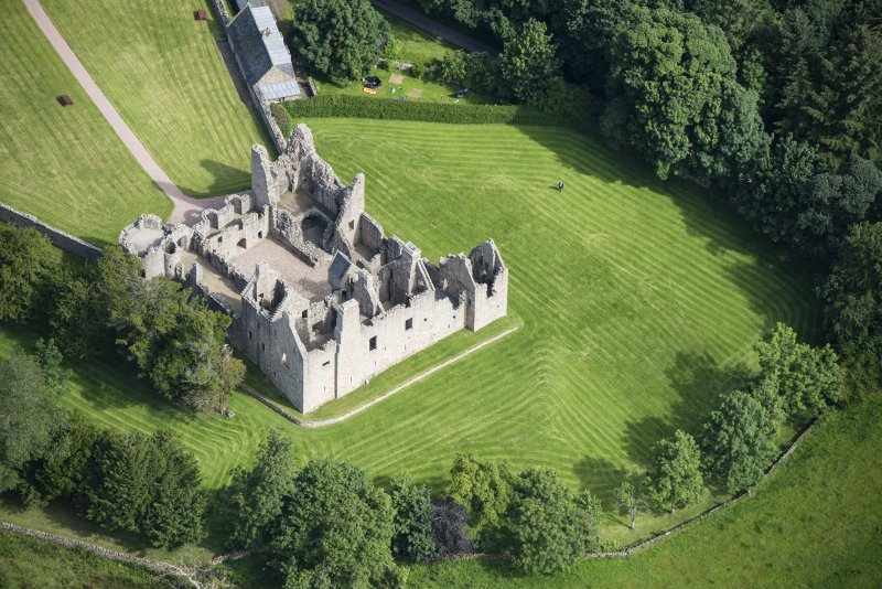Oblique aerial view of Tolquhon Castle, looking NNE.