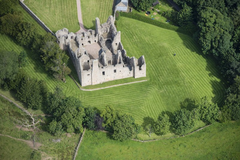 Oblique aerial view of Tolquhon Castle, looking NNW.