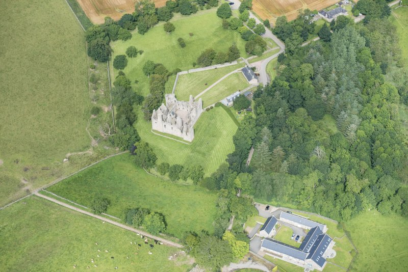 Oblique aerial view of Tolquhon Castle, looking NW.