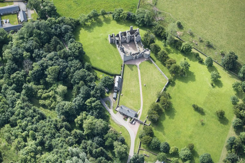 Oblique aerial view of Tolquhon Castle, looking S.