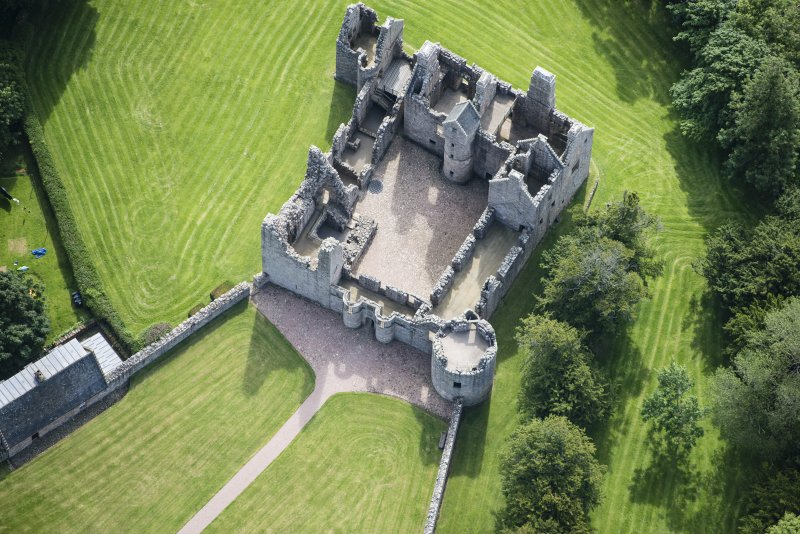 Oblique aerial view of Tolquhon Castle, looking ESE.