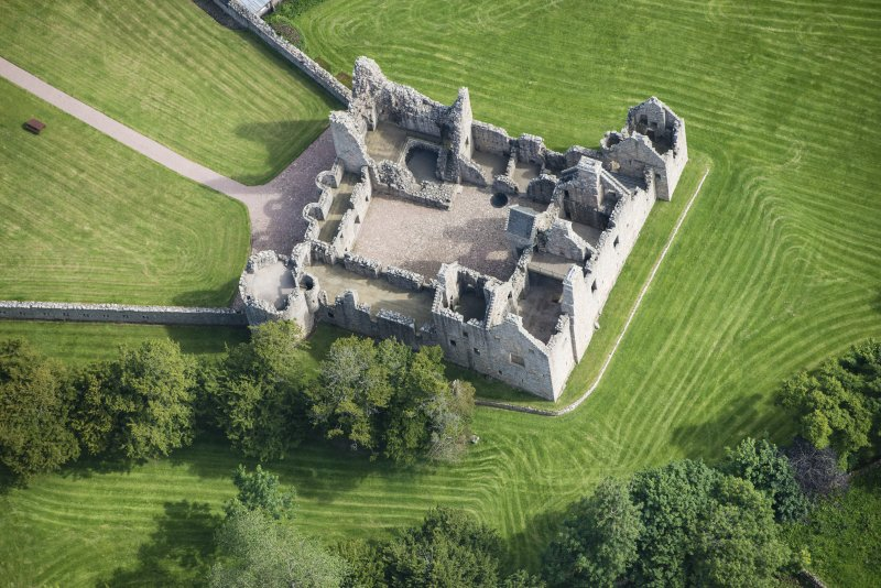 Oblique aerial view of Tolquhon Castle, looking NE.