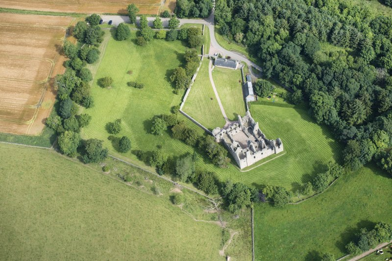Oblique aerial view of Tolquhon Castle, looking N.