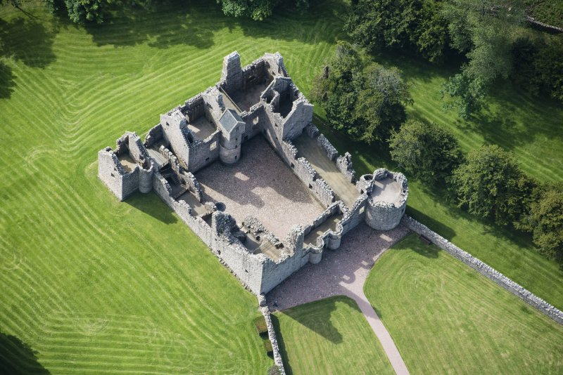 Oblique aerial view of Tolquhon Castle, looking SW.