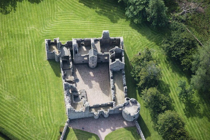 Oblique aerial view of Tolquhon Castle, looking SSE.