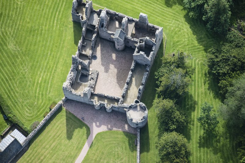 Oblique aerial view of Tolquhon Castle, looking SE.