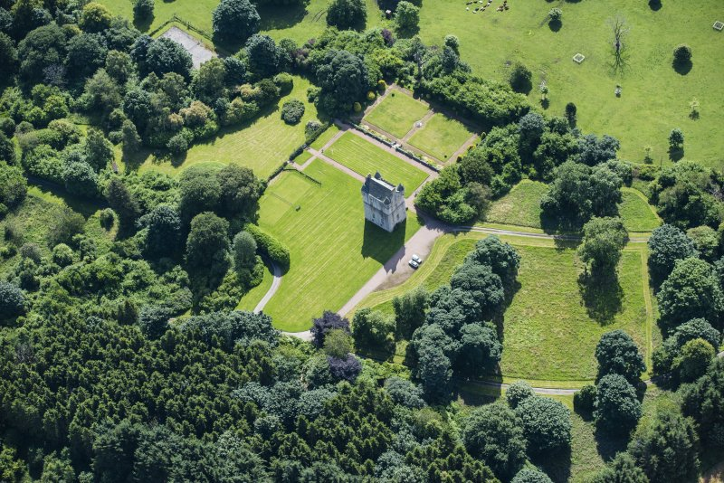 Oblique aerial view of Udny Castle and garden, looking SE.