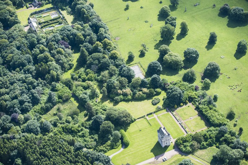Oblique aerial view of Udny Castle, walled garden and garden, looking NE.