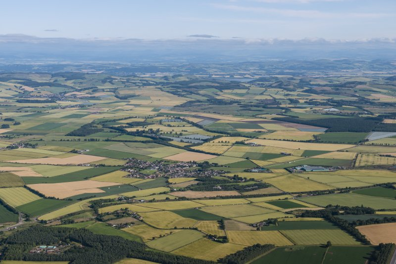 General oblique aerial view of the Howe of Fife with Freuchie and Auchtermuchty in the distance, looking NW.