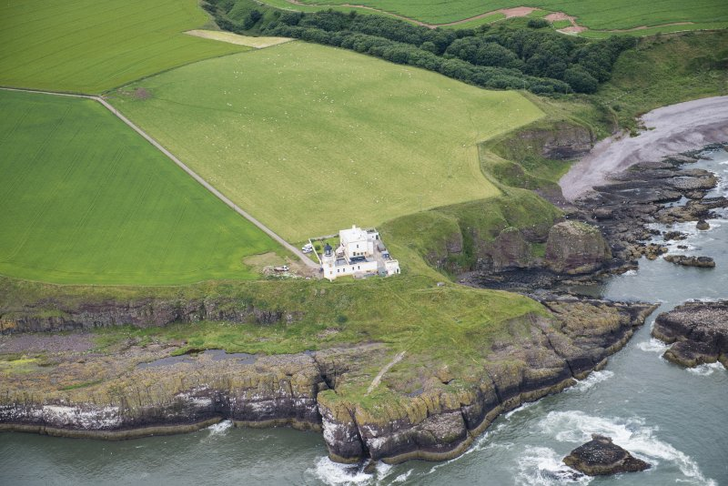 Oblique aerial view of the Todhead Lighthouse, looking WNW.