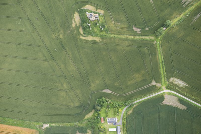 Oblique aerial view of Inchdrewer Castle and the cropmarks of the ditch, looking NE.
