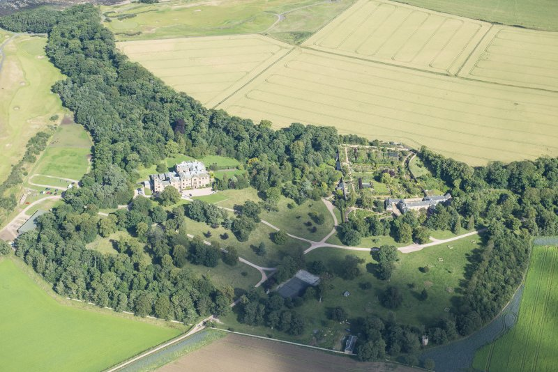 Oblique aerial view of Cambo House and policies, looking E.