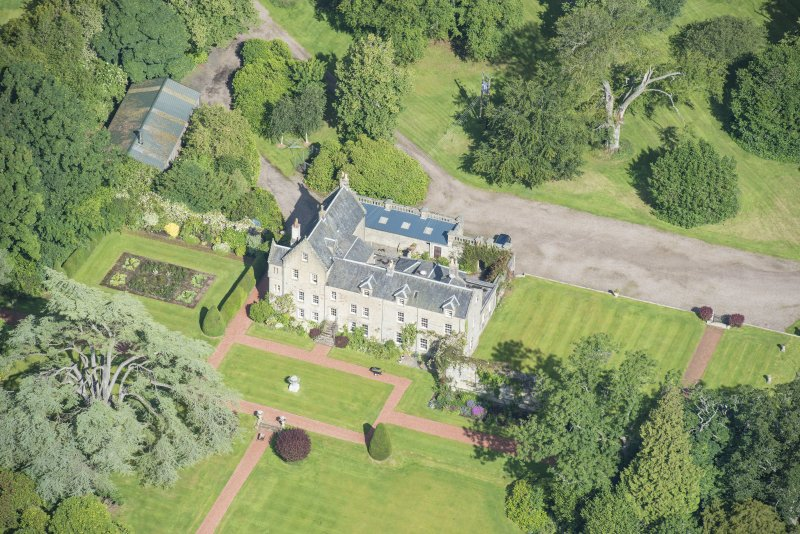 Oblique aerial view of Kirknewton House, looking NNW.