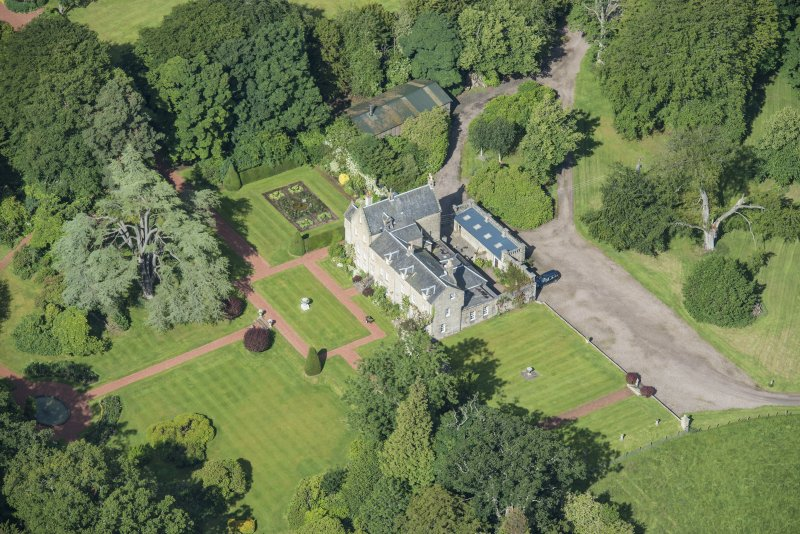 Oblique aerial view of Kirknewton House, looking WNW.