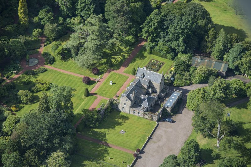 Oblique aerial view of Kirknewton House, looking SW.