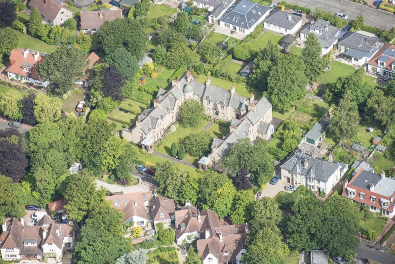 Oblique aerial view of 52 Spylaw Bank Road, looking NW.