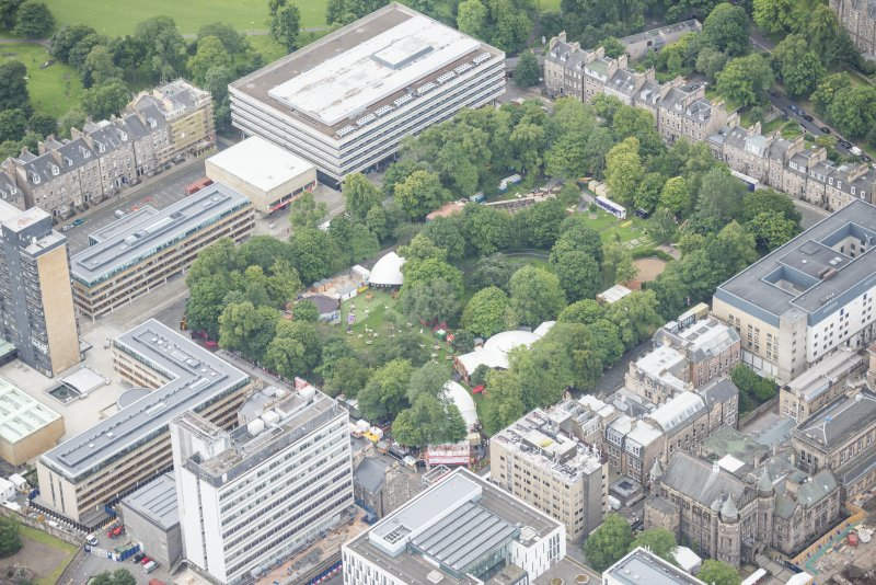 Oblique aerial view of George Square and the Universtiy of Edinburgh Library, looking SSW.