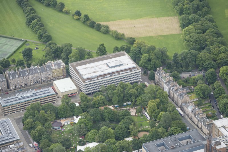 Oblique aerial view of 17-19 Buccleuch Place and University of Edinburgh Library, looking SSE.