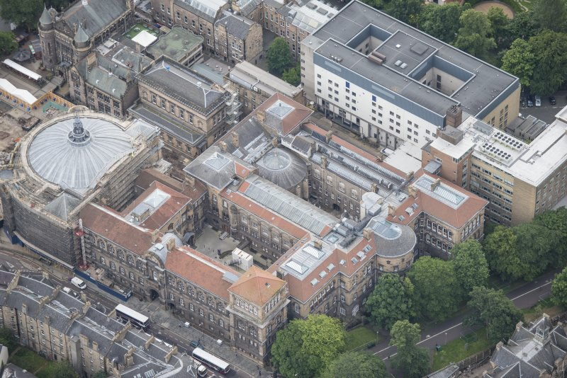 Oblique aerial view of the McEwan Hall and Medical School, looking SE.