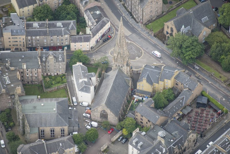 Oblique aerial view of Buccleuch and Greyfriars Free Church, looking SW.