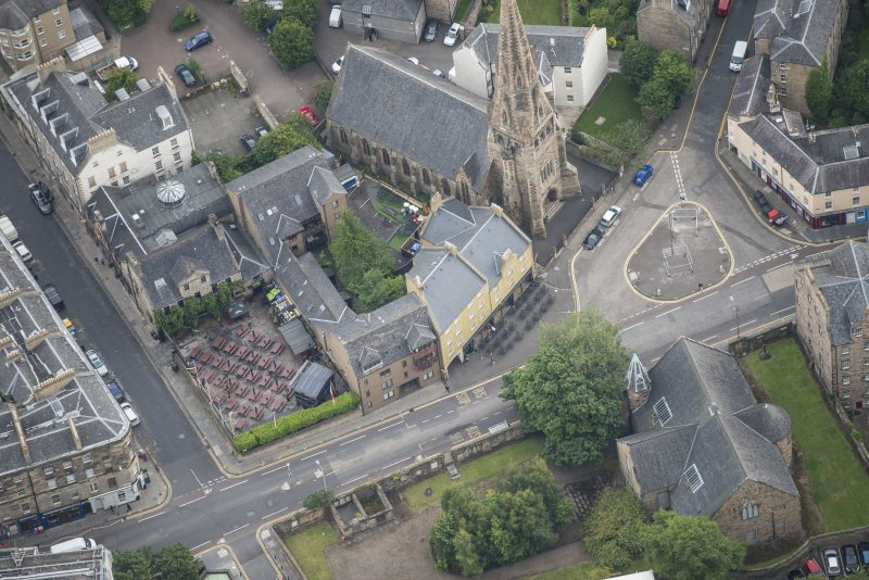 Oblique aerial view of Buccleuch and Greyfriars Free Church and The Pear Tree Public House, looking ENE.