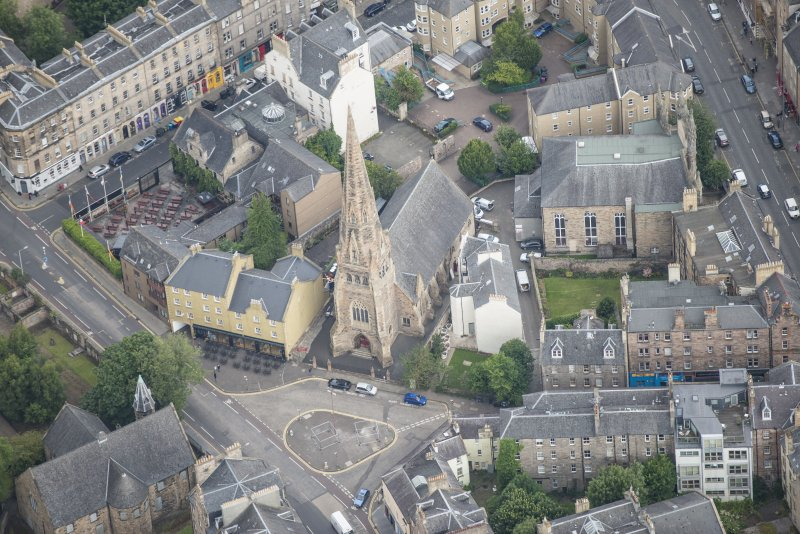 Oblique aerial view of Buccleuch and Greyfriars Free Church, looking N.