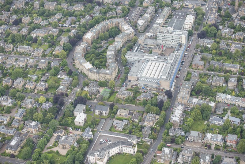 Oblique aerial view of Merchiston Castle, Napier University and Mardale Crescent, looking NE.