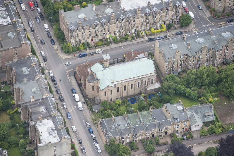 Oblique aerial view of St Peter's Roman Catholic Church and Presbytery, looking SSW.