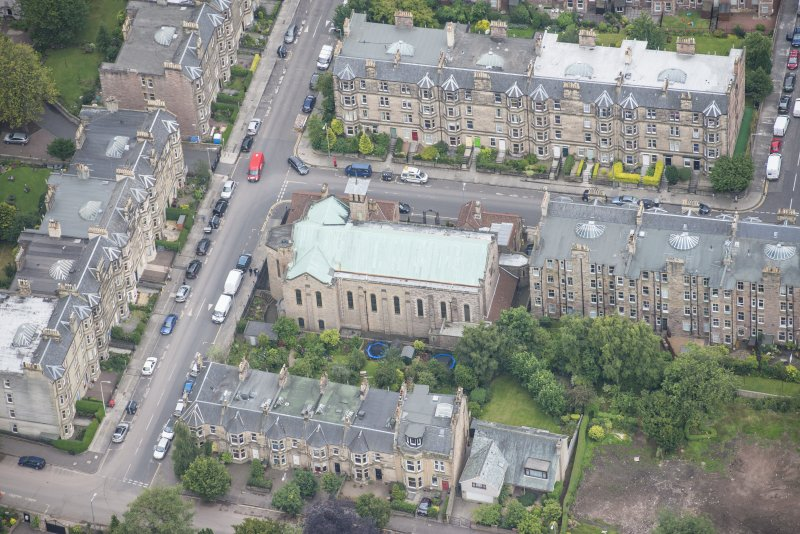 Oblique aerial view of St Peter's Roman Catholic Church and Presbytery, looking S.