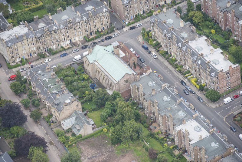Oblique aerial view of St Peter's Roman Catholic Church and Presbytery, looking SE.