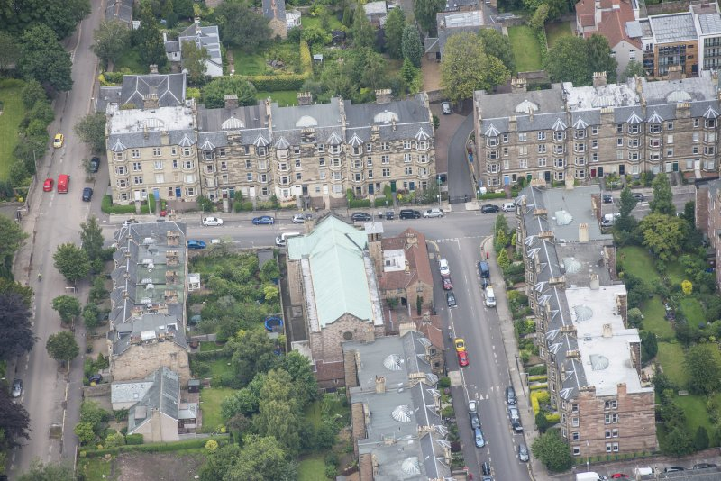 Oblique aerial view of St Peter's Roman Catholic Church and Presbytery, looking ESE.