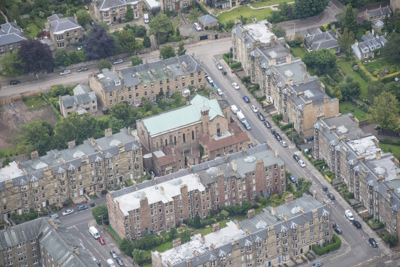 Oblique aerial view of St Peter's Roman Catholic Church and Presbytery, looking NNE.