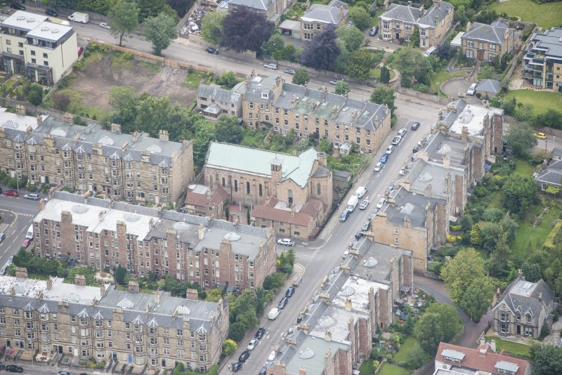 Oblique aerial view of St Peter's Roman Catholic Church and Presbytery, looking NNW.