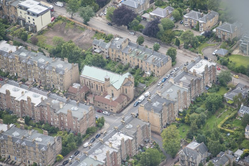 Oblique aerial view of St Peter's Roman Catholic Church and Presbytery, looking NW.